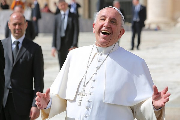 Pope_Francis_laughing_outside_of_St_Peters_Basilica_during_the_general_audience_on_April_1_2015_Credit_Bohumil_Petrik_CNA_4_1_15