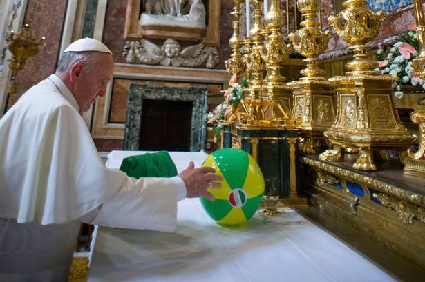 pope-beach-ball-on-altar